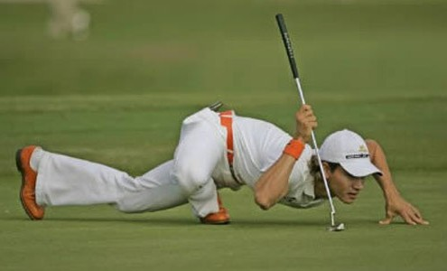 Golf Pro Camilo Villegas in scorpion pose